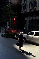 golden (pedro smithson) Tags: park street light shadow red woman architecture lady golden nikon walk candid central sydney streetphotography australia nsw blonde audi harsh oceania oceanica strideby d5100 pedrosmithson
