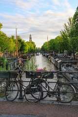 Canal view (opshorton) Tags: flowers trees holland water netherlands amsterdam bike bicycle canal riverboat prinsengracht barge canalboat leliegracht westerkerk