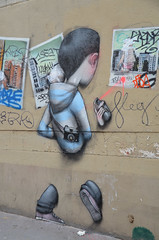 Street artist, with camera, fades into the wall (Monceau) Tags: streetart wall photographer spraypaint disappearing 5tharr
