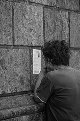 Reading carefully - B&W (Davide Restivo) Tags: street blackandwhite bw italy white black slr digital canon photography eos reflex europa europe italia campania read leggendo 7d napoli naples dslr bianco nero biancoenero carefully leggere readind attentamente
