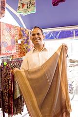 a man who sells batik (sachan) Tags: man singapore   kampongglam