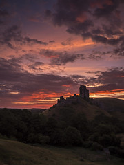 Corfe Castle (Damian_Ward) Tags: morning castle sunrise lumix dawn day cloudy nt ruin panasonic explore dorset redsky fortification corfe nationaltrust dmc westhill williamtheconqueror corfecastle englishheritage scheduledancientmonument purbeckhills 11thcentury mft gnd isleofpurbeck gh3 royalist explored 1445mmlens gradeilistedbuilding leefilters apass damianward damianward micro43 microfourthirds hfs014045 soft06