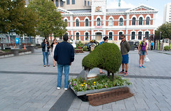 One Large Egg (Jocey K) Tags: flowers trees newzealand christchurch people clouds buildings topiary cbd cathedralsquare archtiecture festivalofflowers