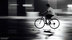 Reflected (2) (disgruntledbaker1) Tags: bw blur rain bike nikon panning 15sec d90 disgruntledbaker