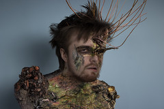 Chronic Portrait (Opofolof) Tags: blue portrait people plant man black tree male green rot eye art nature monster photoshop self canon hair scary model branch sad emotion artistic decay edited roots surreal bark cannon disturbing feeling root emotions chronic parasite illness leeching