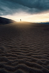 Queen of the Hill (David Colombo Photography) Tags: blue sunset sun storm yellow clouds landscape nationalpark sand nikon desert cloudy outdoor dunes dramatic deathvalley sanddunes d800 mesquitedunes sandripples davidcolombo davidcolombophotography