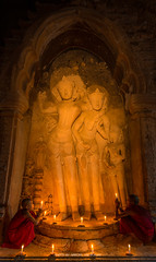 TWO NOVICES PRAY INSIDE THE BAGAN PAGODA (::: a j z p h o t o g r a p h y :::) Tags: travel light sculpture tourism architecture pagoda candles burma pray culture myanmar burmese bagan novice