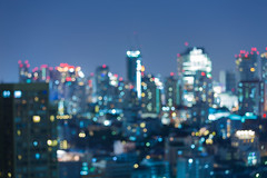 Skyline.Buildings.City.Office.Commercial. (caprightmarketing) Tags: road city travel light sky urban holiday abstract motion blur building lightbulb skyline architecture modern night skyscraper landscape design office blurry twilight highway focus colorful downtown cityscape shine view bright blurredlights bokeh outdoor dusk bangkok circles district background lightbulbs optical blurred landmark spot aerial spotlight midtown round flare bulbs nightsky nightlife effect decorate holidaylights circular cityatnight cityskyline lighteffect nightcity abstractlight lightbackground blurredbackground outdoorlighting urbancity citybackground bokehbackground travelbackground circlebackground blurrybackgrounds lightsbackground
