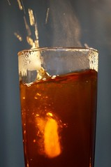 Ice in the tea (Tatters ) Tags: ice water glass minolta tea steam splash iso1600 hotcold macromondays minoltaaf50mmf28macro