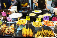 night market hustle (_cherylh) Tags: travel taiwan nightmarket food market snacks shrimps cooking eatery busy hands fujifilm people chaos skewers seafood taipei