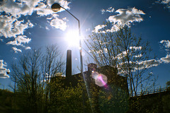 Nuclear (Melissa O'Donohue) Tags: old trees sky sun sunlight abandoned overgrown clouds contrast dark spring nuclear sunny haunted creepy spirits upstatenewyork ghosts blueskies orbs sunspots psychiatriccenter psychcenter