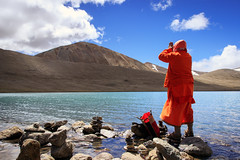 The Devotee at Gurudongmar Lake (Satyaki Basu) Tags: travel people india lake canon indian prayer hills devotee himalayas sikkim t3i 1755 600d northsikkim explored gurudongmar