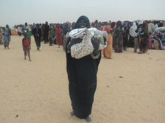 Mauritania woman with commodities offered by LWF (CLWR1) Tags: kits quilts mauritania shipment wecare wecarekits
