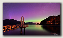 Aurora Borealis at Porteau Cove Provincial Park (Lijuan Guo Photography ( Hollow Bamboo)) Tags: park pink light sea sky mountain color green night island star pier rainbow dock colorful cove britishcolumbia aurora howesound northern borealis porteau auroras boreales