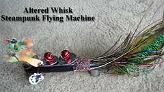 hardware alteredart steampunk shrinkplastic jinglebells peacockfeathers flyingmachine mixedmediaart microbeads alteredwhisk