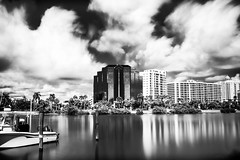 One Sarasota Tower (adamwcameron) Tags: longexposure blackandwhite bw water architecture clouds canon waterfront florida sigma shore nd sarasota fl weldingglass neutraldensity t4i 1750mm