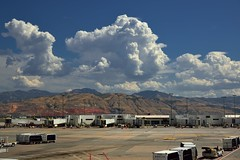 Puffy Clouds and Mountains (thor_mark ) Tags: travel mountains utah airport unitedstates airplanes cities delta saltlakecity urbanexploration day1 slc miscellaneous project365 slcairport mountainsindistance blueskieswithclouds nikond800e airplanesontarmac