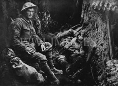 WWI0139B1 (ww1images) Tags: relax soldier post mud sleep cigarette smoke helmet cable rest british doze dugout troops weary corrugatediron sandbag allied puttee briodie funkhole trenchtelephone