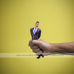 Squeezing the worker (Hands project 7/100) (Helder Almeida) Tags: businessman pain hand power oppression squeeze business problem effort difficult concept press pressure stress fragile struggle career difficulty oppressed