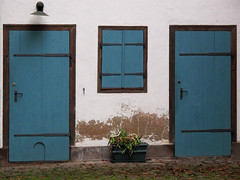Which door would you choose? (Batikart) Tags: wood flowers blue windows winter light urban white house black flower building window lamp lines architecture canon germany square geotagged deutschland triangle europa europe day doors outdoor fenster eingang details january entrance haus symmetry cobblestone pot harmony simplicity shutter archite