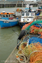 Boats and fishing nets at Whitstable Harbour, Kent, England (Roberto Herrett) Tags: uk travel england net tourism k vertical harbor boat town kent colorful europe unitedkingdom britain tourist quay u colored colourful quays towns coloured whitstable harbors harbours stockphoto rherrettflk