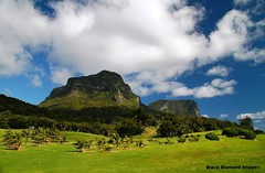 Rural Views Across the Golf Course to Mt Lidgbird and Mt Gower From Near Lord Howe Island Golf Course (Black Diamond Images) Tags: golfcourse australia lordhoweisland nsw views beach ruralviews mtlidgbird mtgower lordhoweislandgolfcourse fairway clouds thelastparadise nswnationalparks