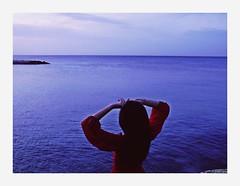 Olta (L'instant c'est moi) Tags: ocean blue sunset sky water girl seaside arms conceptual reddress