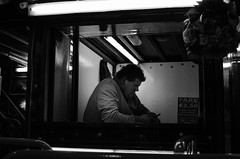 Familiar Strangers IV (PirateChristoph) Tags: street uk greatbritain flowers light england people urban blackandwhite bw white black streets monochrome digital work tickets person mono nikon alone phone ride fairground leicestershire unitedkingdom working bored streetphotography fair stranger streettrader markettown fare loughborough familiar ticketbooth streetshot familiarstrangers blackandwhitestreetphotography d7000 chrisfenton piratechristoph