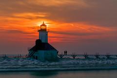 St. Joseph Lighthouse at sunset (tquist24) Tags: winter lighthouse ice clouds geotagged nikon unitedstates michigan stjoseph lakemichigan saintjoseph skyevening stjosephlighthouse nikond5300
