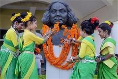 Agartala: School girls in traditional attire pay tributes to the statue of Bengali poet Kazi Nazrul Islam on his 118th birth anniversary celebrations at 24th may. (legend_news) Tags: school girls statue anniversary islam traditional birth may celebrations pay poet his tributes 24th bengali attire nazrul kazi 118th agartala