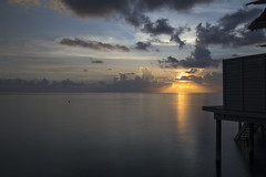 Maldives Sunset (Benjamin Griffiths) Tags: ocean sunset sun holiday water clouds sundown indian rays resorts maldives ras bungalow centara funshi
