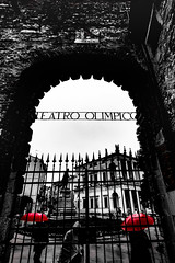 comparse (AOP fotografia) Tags: street city red people urban white black monochrome look rain weather rock wall umbrella out teatro mono gate italia theatre walk monumento wide perspective streetphotography spot reflected frame fujifilm inside rosso vicenza 1024 ombrella xt1 comparse