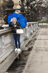 Please, rescue me! (dorablanco) Tags: camera bridge blue paris girl rain azul walking puente photo lluvia loneliness foto chica paseo soledad