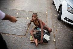 A disfigured beggar in Mumbai, India. (cookiesound) Tags: poverty life street travel people india money canon photography expression homeless documentary streetlife beggar bombay mumbai slums homelessman toughlife travelphotography travelphotographer cookiesound nisamaier ullimaier disfiguredman