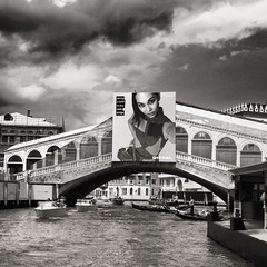 Work on progress. Venice it's becoming a place to make a selfie and nothing else. (acid_nam) Tags: billboard blackandwhite biancoenero blancetnoir rialto venezia lumix venice bnw bn