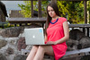 Work anywhere (Janis Baiza) Tags: pink blue woman girl work hair necklace long dress legs serious laptop working anywhere intent