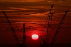 Cranehenge-IMG_9669 (johnruscombe1965) Tags: newyorkcity sunset red sky orange ny newyork yellow evening construction manhattan unitedstatesofamerica cranes westside midtownmanhattan landscapecityscape hudsonyards constructionscape