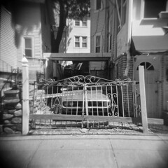 A Gated Community (LowerDarnley) Tags: houses car ma holga gates driveway somerville fenceposts 120n