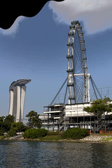 Cartoon - The Singapore Flyer, the Marina Bay Sands and the top part of the boat (Ashish A) Tags: trees cloud building tree tourism water clouds canon buildings asian singapore asia action cartoon tourist observationplatform ferriswheel canondslr digitalslr touristattraction cloudysky canonslr cloudsinsky singaporeflyer marinabaysands singaporeducktour marinabaysandsresort canon550d canont2i singaporeflyercapsules viewfromsingaporeducktour