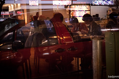 Holding On (badjonni) Tags: street people reflection car diner dining chineserestuarant