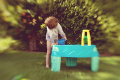 Summer loving (catherinelacey68) Tags: blur green water lensbaby backyard bokeh happiness waterplay