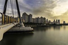 Sky Rift (Goderic Tia) Tags: bridge light sunset detail architecture clouds contrast buildings landscape golden nikon singapore day cityscape daily creation storey hdb indoorstadium tanjongrhu d7000 cloudsstormssunsetssunrises