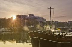 Royal Theatre Carré (Arne Kuilman) Tags: morning sky sun netherlands amsterdam river boat nederland explore lensflare rays zon edit amstel ochtend carré rivier zonnig zonnestralen explored theatercarré