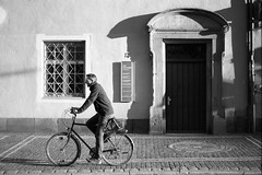 And he's off to the next adventure (Nekr0n) Tags: street door old city morning 2 urban blackandwhite bw man slr film monochrome bike 30 35mm canon vintage germany deutschland eos 50mm blackwhite nikon university 33 alt strasse rad grain streetphotography 7 delta ishootfilm nostalgia summicron negative r stadt streetphoto 100 f2 uni universitt 135 elan 5000 50 freiburg schwarzweiss baden altstadt coolscan morgen ilford manualfocus tr v2 e55 leitz 7e analoge eica primelens strase filmisnotdead summicronr leicasummicronr50mmf2e55 bertoldstrase imbreisgau