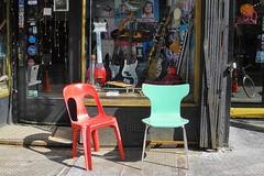 musical chairs (omoo) Tags: newyorkcity window store chairs display guitars streetscene greenwichvillage musicalchairs musicalinstruments plasticchairs electricguitars musicinn dscn9215 themusicinn wst4thstreet nexttothepinkpussycat
