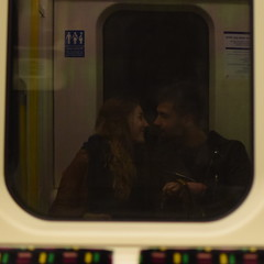 Underground Kiss (danielsaville) Tags: city portrait urban selfportrait reflection london window face train underground nikon kiss metro transport tube lovers commute frame intimate d3300