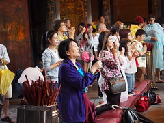 Taiwanese people during prayer at one If the temples in Taipei!
