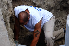 Down in the hole and hard at work (BDRoth (trying to catch up!)) Tags: man texture rock tattoo beard person construction hole arm muscle candid working tan human hombre homme stubble