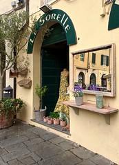 Lucca, piazza dell'anfiteatro (Irene Grassi (sun sand & sea)) Tags: italy shop reflections mirror italia lucca tuscany negozio toscana riflessi specchio anfiteatro bottega botteghe piazzadellanfiteatro lesorelle