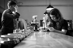 Social Media And Flat White (nigelhunter) Tags: street light urban white coffee girl mobile shop bar point nose cafe phone flat candid ring jar barrista vanisshing